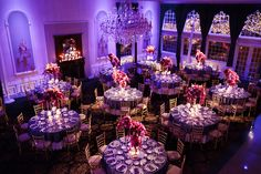 Florentine Gardens. Deep purple and fuchsia orchids, hydrangea, roses, calla lilies and snap dragon all styled in various glass vases with crystal accents at the base. By Diana Gould Ltd. Photo by LoRusso Studios.