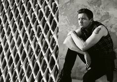 Black and White Photo of Jeremy Wearing Black Sleeveless Top and Jeans in Flaunt Magazine Photo Shoot