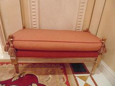Lot 235 - Italian Neoclassical style carved and gilt wood upholstered window bench leaf and ribbon carved