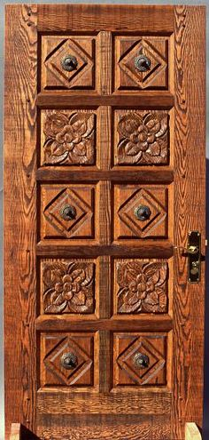Carved rustic fir door with Mexican rossetts