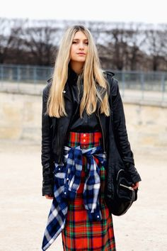 Street style: Blogger and model Natascha Elisa layers her leathers. Leather button down layered with a leather moto jacket over tartans and plaids.