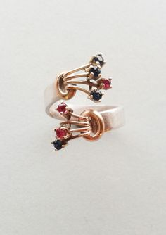 Gold claw ring.  Up cycle with 18ct gold with small faceted gemstones.  Handmade by Reshma Tia Champaneria jewellery