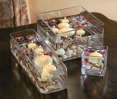 Floating candles, flowers and pebbles in glass containers for wedding table decor Diwali Decorations, Centerpiece Decorations, Decoration Table, Wedding Centerpieces, Wedding Table, Wedding Decorations, Wedding Reception, Bowl Centerpieces, Reception Ideas