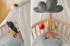 blick7: Mobile Wolke Regentropfen über Kinderbettchen