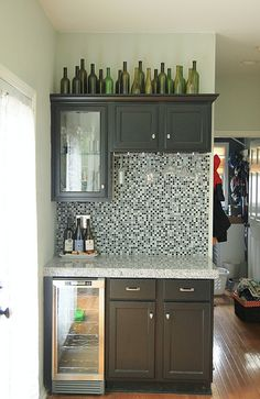 bottles on top of cabinets