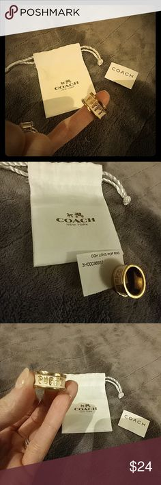 """Coach """"POPPY"""" Enamel Ring This is a fun Coach ring!!   Very cute!!! Like new....nothing wrong with it at all. COACH stamped on the inside. Ring reads : COACH 💖POPPY. Enamel is a soft white, almost a powdery pale pink tone, but more of a white color, I believe. Comes with part of the original tag AND the little white drawstring bag. See more jewelry posted in my closet!! Bundle to save yourself $$ and save on shipping.  Thanks :) Coach Jewelry Rings"""