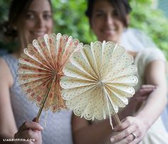 These fold-able paper DIY fans are so easy to make with a video tutorial and the Cricut Explore machine. Perfect for your DIY wedding.