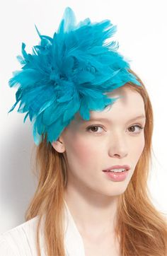 This is a great, dramatic headpiece.  And if you hate your bridesmaids, it's good for that too.