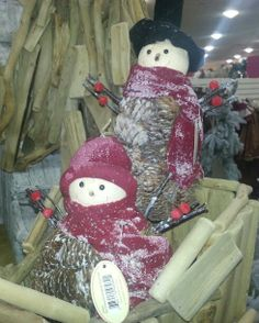 Pinecone Christmas decorations.  Snowmen. DIY Inspiration. Found at Home Goods.