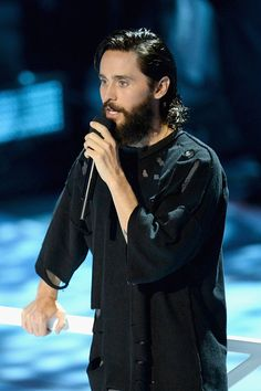 Jared speaking on stage at the VMAs 2017