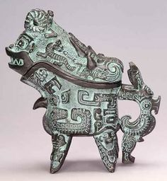 Bronze Bird and Beast Carving Wine Server was made during Shang dynasty 1200 to 1100 B.C