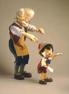 """RJW Dolls - Geppetto and Pinocchio I Marionette. 18"""" and 9"""" molded felt and hand carved Alpine maple, fully jointed. Date of Release: 1994-95. Ltd. Ed. 500."""