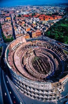 Aerial view of the Colosseum, Rome, Italy. With Rome's gay area, well street really, directly behind it.