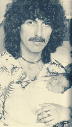 George H. Harrison and baby Dhani Harrison THIS THE SPITTING IMAGE OF MY BOYFREIND TONY GOOD  NO WONDER I LOVED TONY!!!!!!  IN 69--72