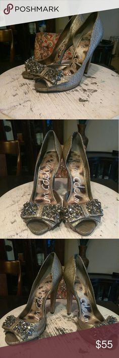 JUST IN!!! Sam Edelman-Lorna Pewter Tis' the Season!!! Time to bring out all of those fabulous blinged out heels to throw on with a dress and look FAB!!! Pewter leather peep-toe w/embellished bow on toe (every spike/stone are intact 😉) , 4.5in heel!!! Minor wear on bottoms (shown above not noticeable when wearing) great condition inside and out!!! Let's make some offers Ladies!!! Sam Edelman Shoes Heels