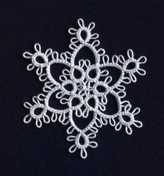 """Speaking of Myra Piper's """"Tatting"""", here's another little snowflake I'm quite fond of. It's a slightly modified version of motif #4 (the pa..."""