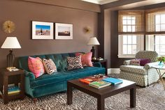 Neutral is anything but boring when you choose deep hues of brown and green to add richness to the room. Textures from the rug, chair, and pillows give personality to a space dominated by earth tones.   - GoodHousekeeping.com