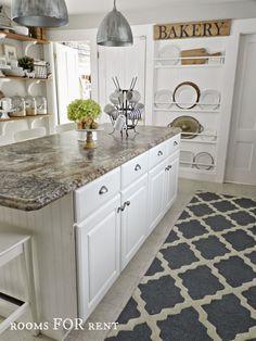 White farmhouse kitchen, barn light pendants, built in plate rack, morrocan trellis rug from @rugsusa