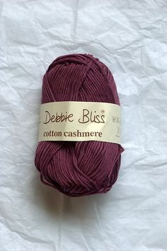 Debbie Bliss Cotton Cashmere (discontinued); DK / 8 ply (11 wpi); 103 yards (94 meters) 50 grams (1.76 ounces); 85% Cotton  15% Cashmere  Machine wash?  yes Yards, Knitted Hats, Bliss, Cashmere, Winter Hats, Sweater, Knitting, Sleeve, Cotton