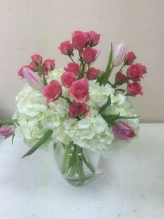 tulips, hydrangea, and mini spray roses! From local florist Bozzay Florist of St. Louis, MO