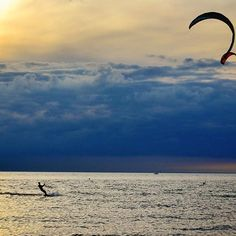 Things to do in Holland, MI -- Good morning, Pure Michigan! We thought we'd start the day by sharing this incredible shot of a kiteboarder at Holland State Park, shared by @thawanderer88 ! How have you been spending your weekend in the Great Lakes state? @discoverholland #PureMichigan
