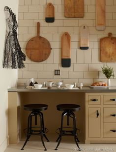 Wooden cutting boards hung in the kitchen - The Mondern Pantry