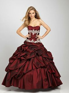 Fabulous full skirted burgundy ball gown by Allure Prom.