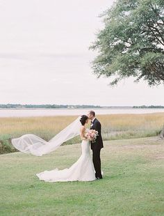 Michelle & John pose in front of the Ashley River at Lowndes Grove Plantation | November wedding inspiration in Charleston, South Carolina | Photo by Landon Jacob