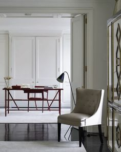Red leather desk and chair by Jacques Adnet in the home of London Designers'   Carole Katleman and Daniel Cuevas #JacquesAdnet