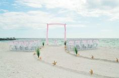 Dusty pink sashes and tulle on the arch create a dreamy setting at 2nd Ave, Pass-a-Grille