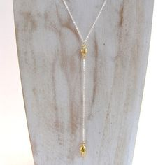 Long sterling silver necklace with 22ct gold-plated textured oval bead and teardrop bead. Chain is 80cm to oval bead, drop chain with teardrop bead is an additional 10cm.