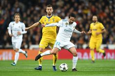 Isco of Real Madrid is challenged by Miralem Pjanic of Juventus during the UEFA Champions League Quarter Final Second Leg match between Real Madrid and Juventus at Estadio Santiago Bernabeu on April 11, 2018 in Madrid, Spain.
