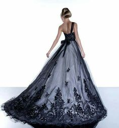 Black embroidered tulle over white gown with chapel train.