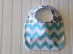 This listing is for one Aqua Chevron and Bicycles Baby bib.    Adorable chevron stripe bib and bicycles!    Front features cotton chevron fabric