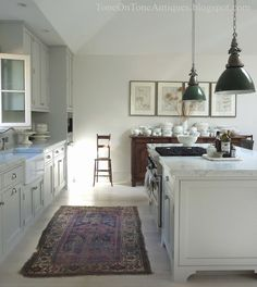 green lighting.  rug.  Stunning white kitchen and home tour eclecticallyvintage.com