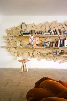 Inspired by their award-winning Favela chair, 1991, the central panel made from scrap wood works as a bookshelf to store books and CDs and also houses the television.