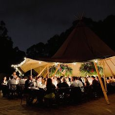 Dine under a starry sky and tent for your bohemian wedding or dinner party.. oh and how about those floral chandeliers?!