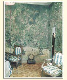 Pauline de Rothschild in her Paris apartment bedroom, decorated in 18th century chinoiserie wallpaper