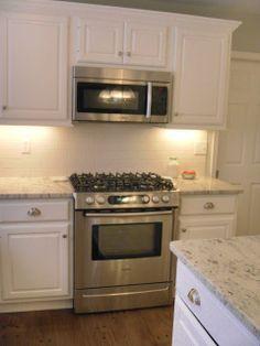 River White Granite with White Cabinets
