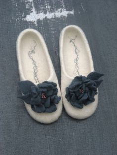 """Elegant white felted slippers """"Winter Call"""", felted flowers. $70.00, via Etsy."""