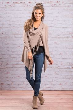 """""""Epitome Of Fall Fringe Cardigan, Taupe""""This cardigan is the best of everything! It's part cardigan, it's part top, it's all amazing! There is a button on one shoulder to make this fab cardi a little more like a top. #newarrivals #shopthemint"""