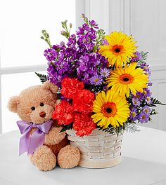 Sunflowers and purple stock... Picture shows gerber daisy and carnations... Replace with sunflower