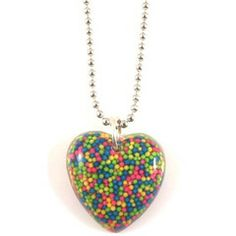 """Kitsch and colourful handmade resin heart pendant filled with green, blue, yellow and pink sprinkles.On a 18"""" silver plated ball chain. As this necklace is hand made the one you receive will differ very slightly from the one shown."""