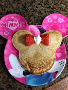 Chocolate chip Minnie Mouse pancakes with a bow for my birthday girl today.