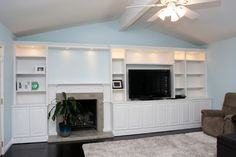 Pacific Coast Custom Design.  Striking custom cabinet wall with fireplace. Beautiful family room wall just waiting to be decorated.