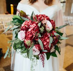 Make This Look!   Flowers By: Laura ♦ Decatur, GA Photos By: Lindsay Pigford     Create a garden look with this trending color palette! Deep reds combine with soft pinks to create a look that is truly romantic. Hypericum berries and astilbe add varying textures while the mix of greenery keeps the look fresh and vibrant! You can't go wrong with this trending look!