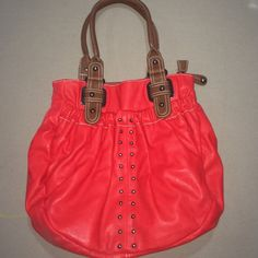 NEW Charming Charlie's red leather should bag Never used!!! Super cute! Red faux leather body with brown faux leather handles. Front pocket, main zipper pocket and zipper pocket on back. Charming Charlie Bags Shoulder Bags