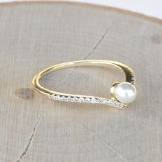 Take out the pearl and this would be a gorgous wedding band