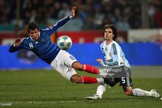 Yoann Gourcuff (L) of France is fouled by Fernando Gago (R) during the International Friendly match between France and Argentina at the Stade Velodrome on February 11, 2009 in Marseille, France.