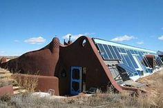 "Called ""Sol Ship,"" this one-bed, one-bath earthship is designed for off-the-grid living and uses passive solar thermomass construction that heats and cools the interior.  Taos, NM"